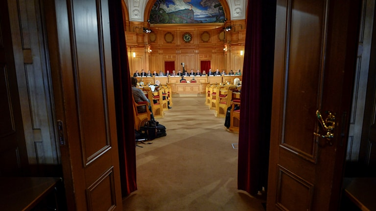 Wood doors opening onto a chamber in Parliament