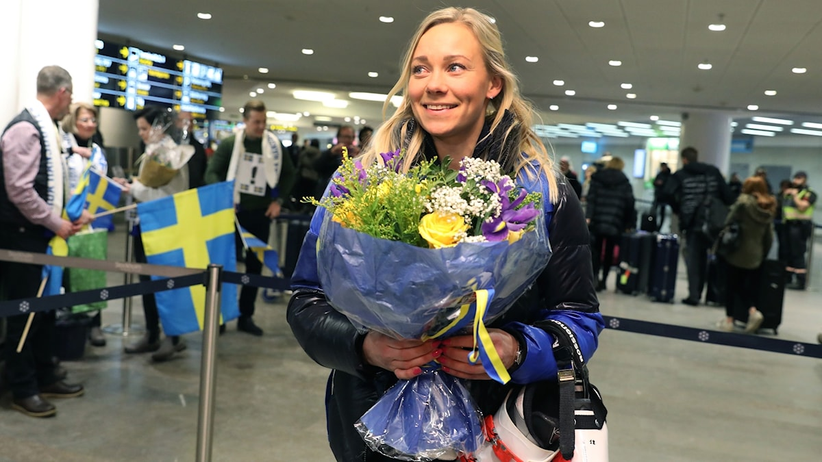 Alpine slalom gold winner Frida Hansdotter is greeted at Arlanda airport. The women took five out of seven gold medals for Team Sweden.
