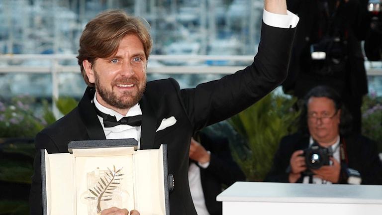 Rubin Östlund celebrates with his Palme d'Or on Sunday.