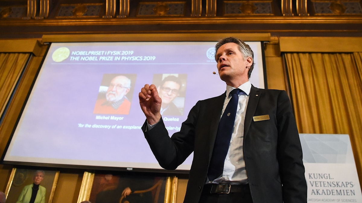 Ulf Danielsson, member of the Nobel Committee for Physics, talking at the Nobel Prize announcement for physics.