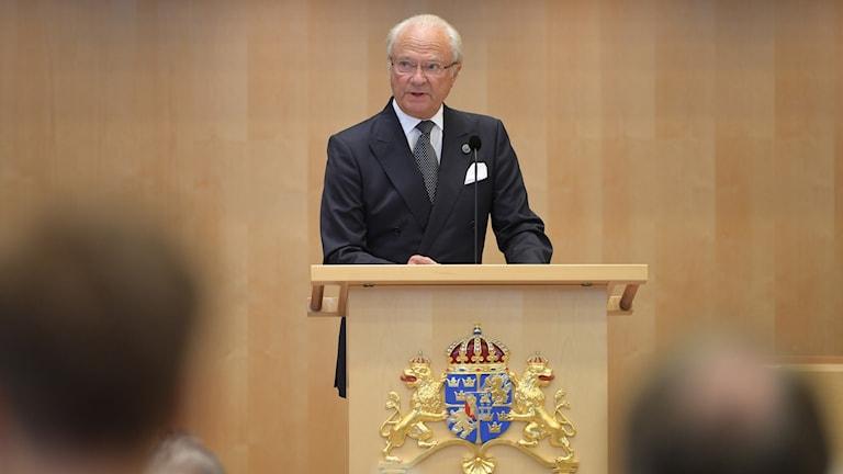 King Carl XVI Gustaf speaking before Swedish Parliament.