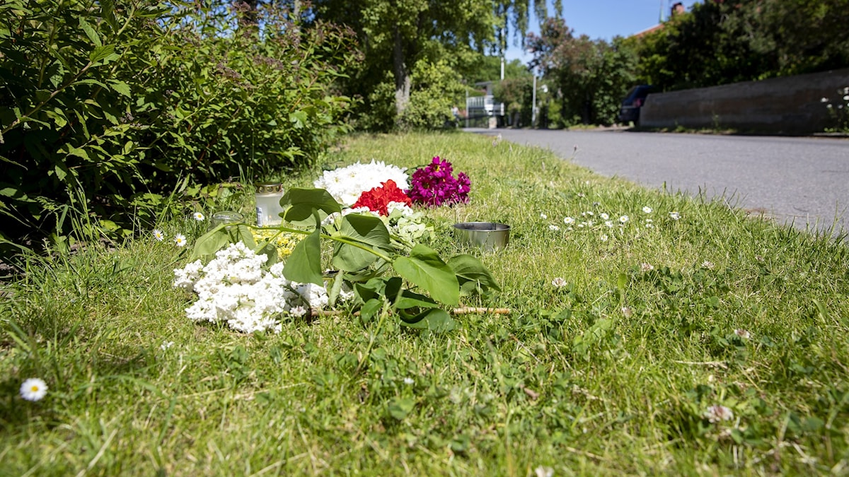 Flowers left as a memorial at the place of one of the murders.