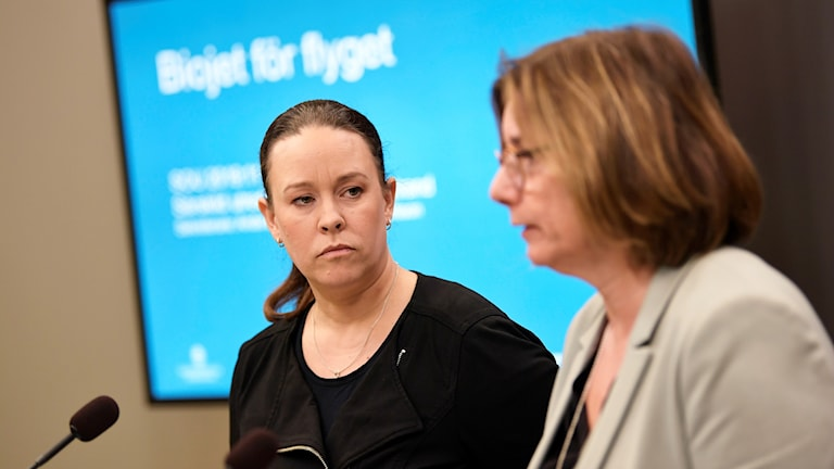 Two women at a press conference