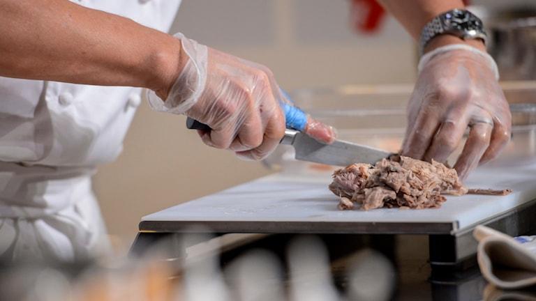 A chef chopping food.