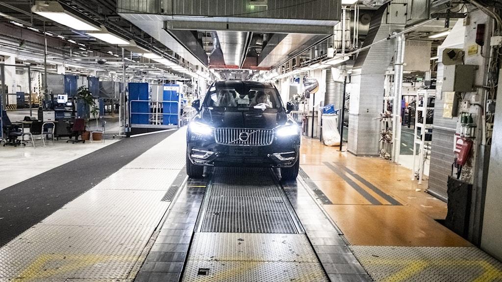 A car inside a factory.