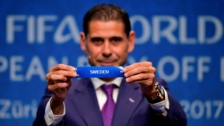 Former football player for Spain, Fernando Hierro, shows the name of Sweden during the FIFA football World Cup 2018 European play-off draw, on October 17, 2017 in Zurich.