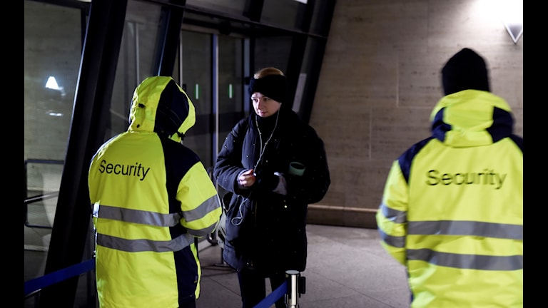 Security checking a women's ID in Denmark.
