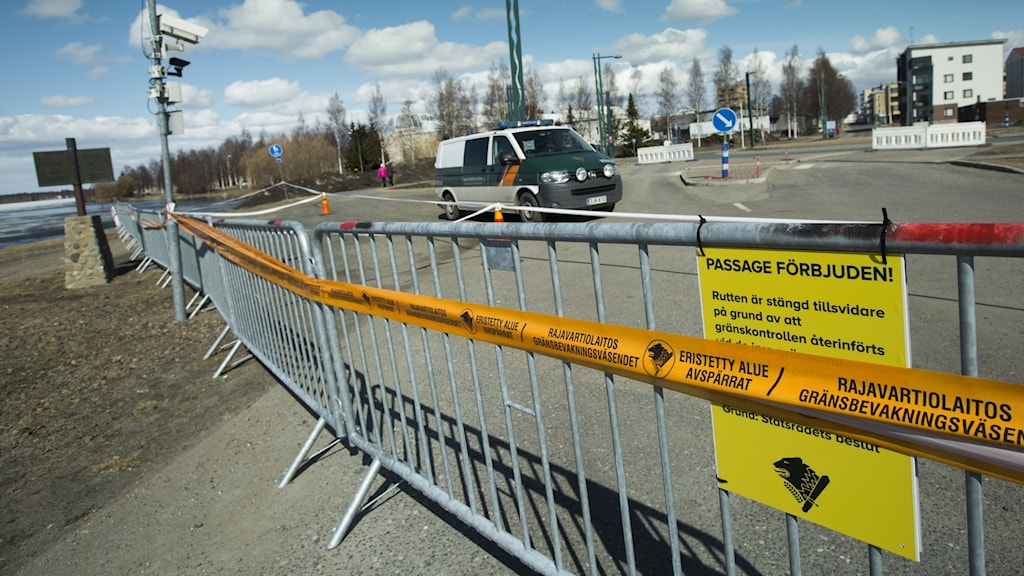 A barriar across a road showing the border into Sweden