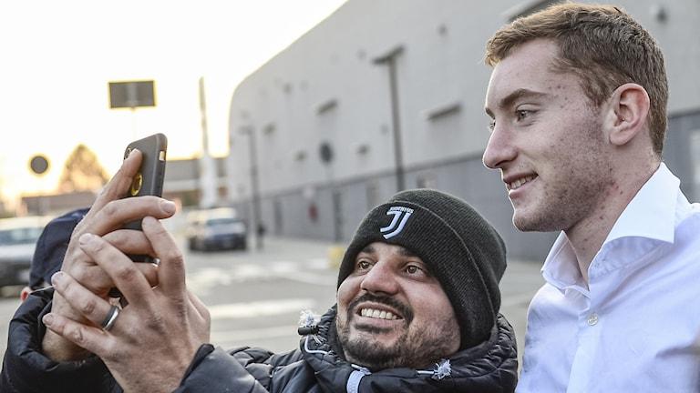Two men taking a selfie.