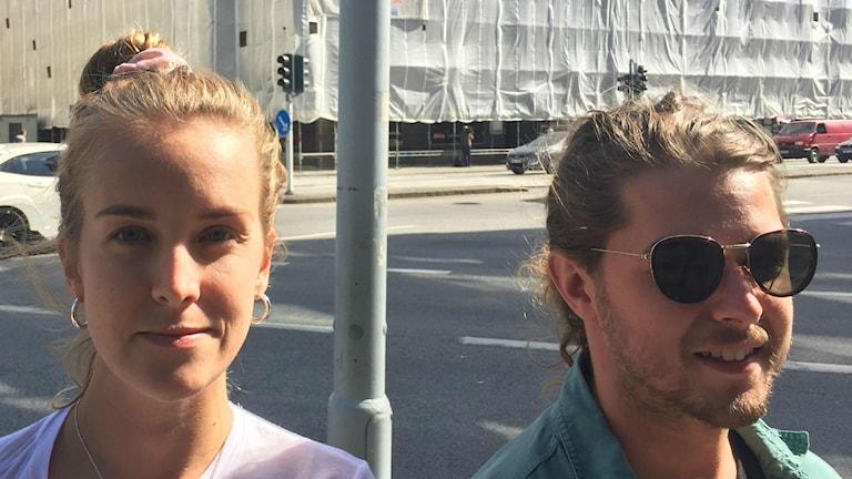 Australian Ryan Vasiliades (right) and his Swedish girlfriend Sara Jungegren (left) across the road from the Galaxy cybercafé.