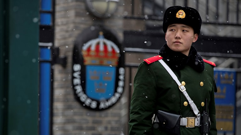 A man in uniform outside a building.