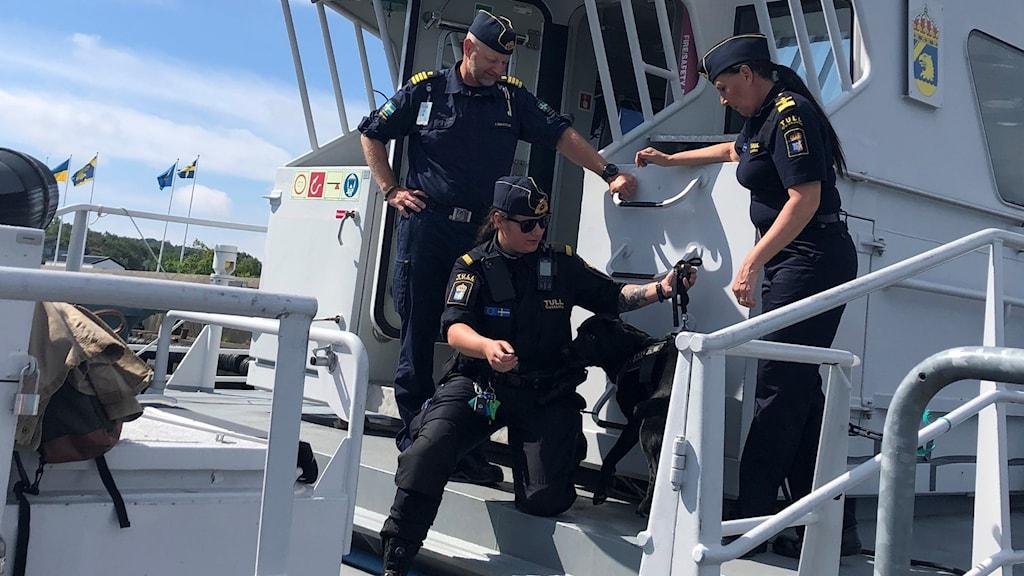 Personnel on board a coastguard ship.