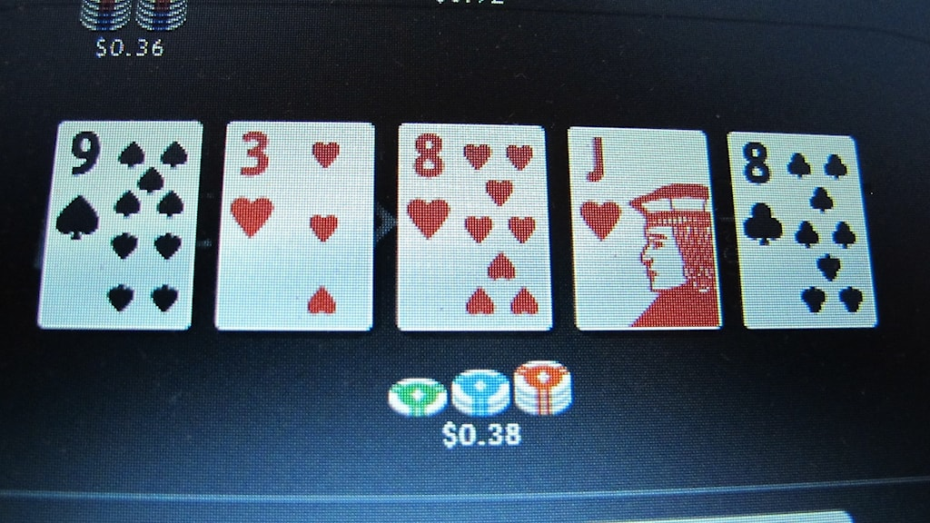 A screen showing a poker game