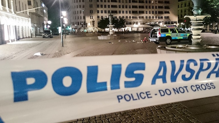 Police investigate a recent shooting in Malmö in June.
