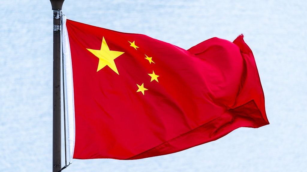 The Chinese flag flying.