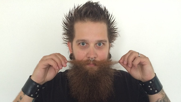 Andreas Fransson, one of the organizers of World Beard Day in Stockholm on Saturday, shows off his moustache. Photo: Radio Sweden
