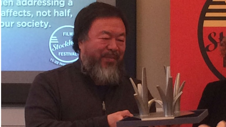 Chinese artist Ai Weiwei holds the Stockholm Impact Award sculpture, which he designed. Photo: Ulla Engberg/Radio Sweden