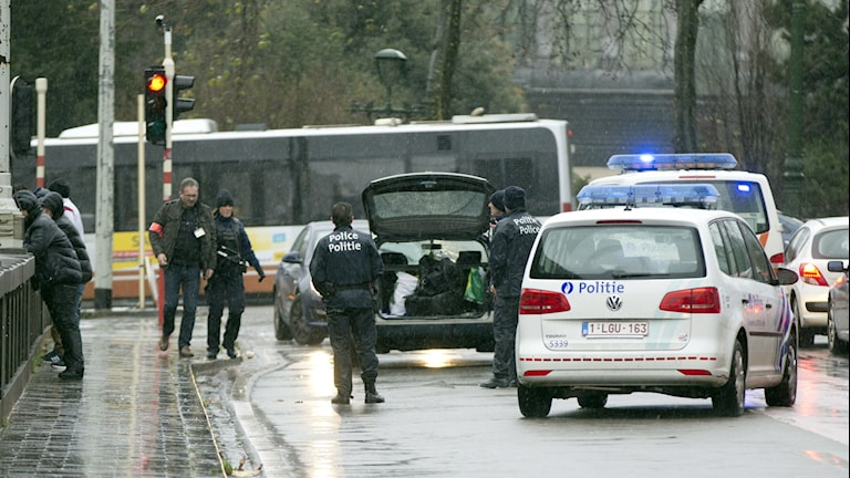 Belgium police search a car in Brussels on Saturday. Photo: Virginia Mayo / AP.