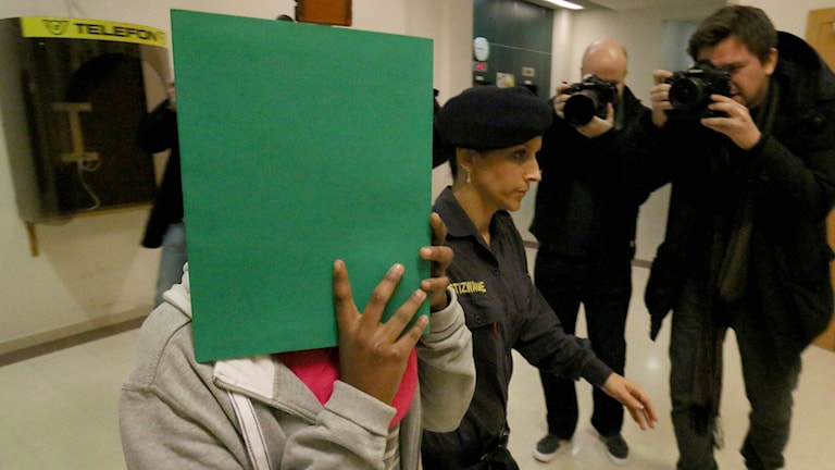 A 17-year-old Swedish woman who is suspected to be an Islamic State supporter arrives for the start of her trial.