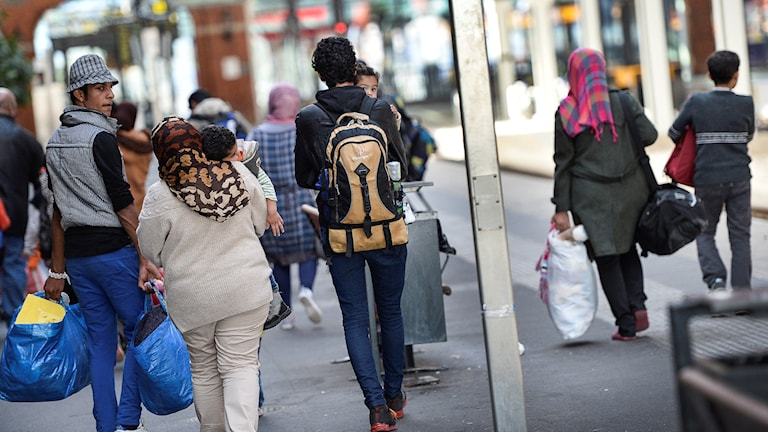 Asylum seekers walking through the streets of Malmö, southern Sweden.