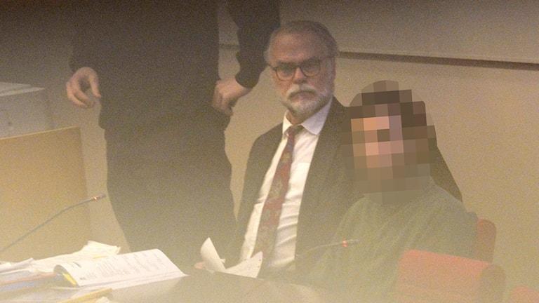 The suspect sitting in Attunda District Court. Photo: Janerik Henriksson / TT.