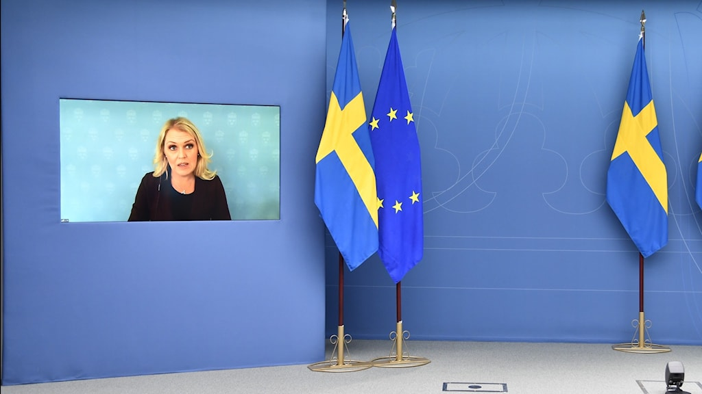An image of a woman on a TV screen in an empty room.