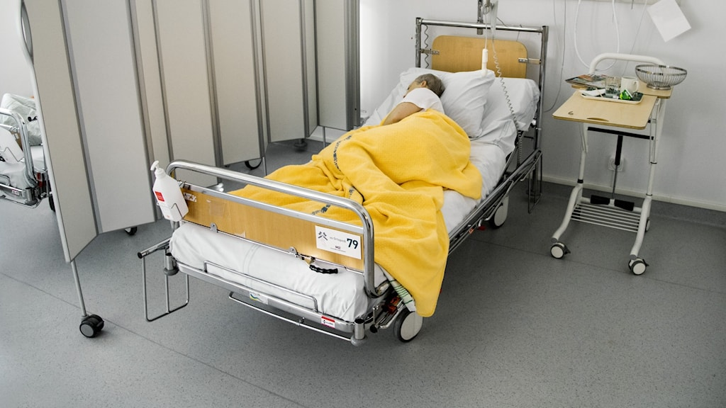 A person lying down on a hospital bed.
