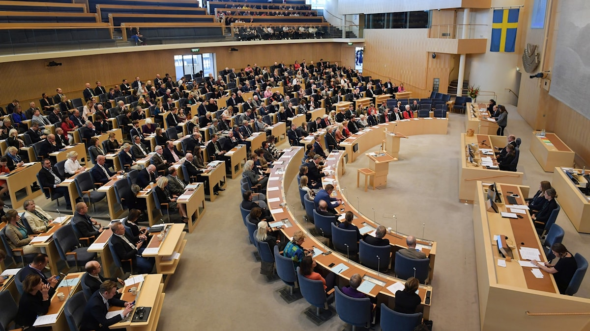 Picture of MPs in their seats inside the Swedish parliament.