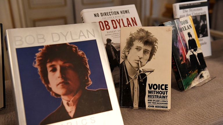 Bob Dylan records stacked on table