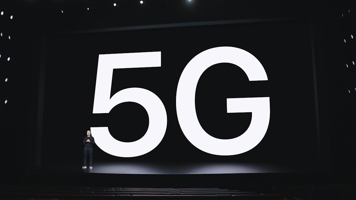 A stage with huge lit letters saying 5G