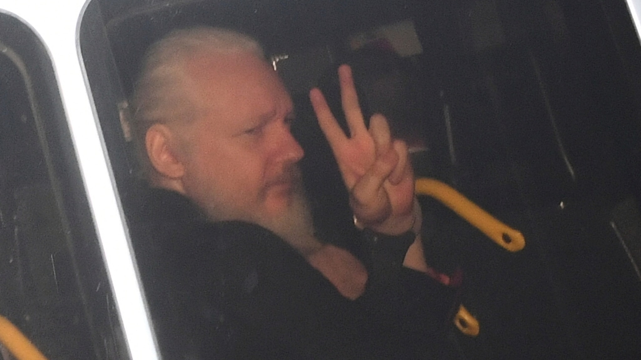 A man giving the peace sign.