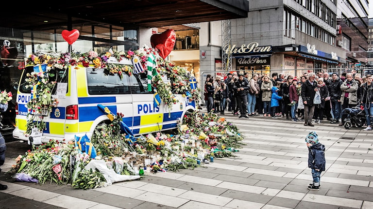 Flowers on a police van close to the site of the attack