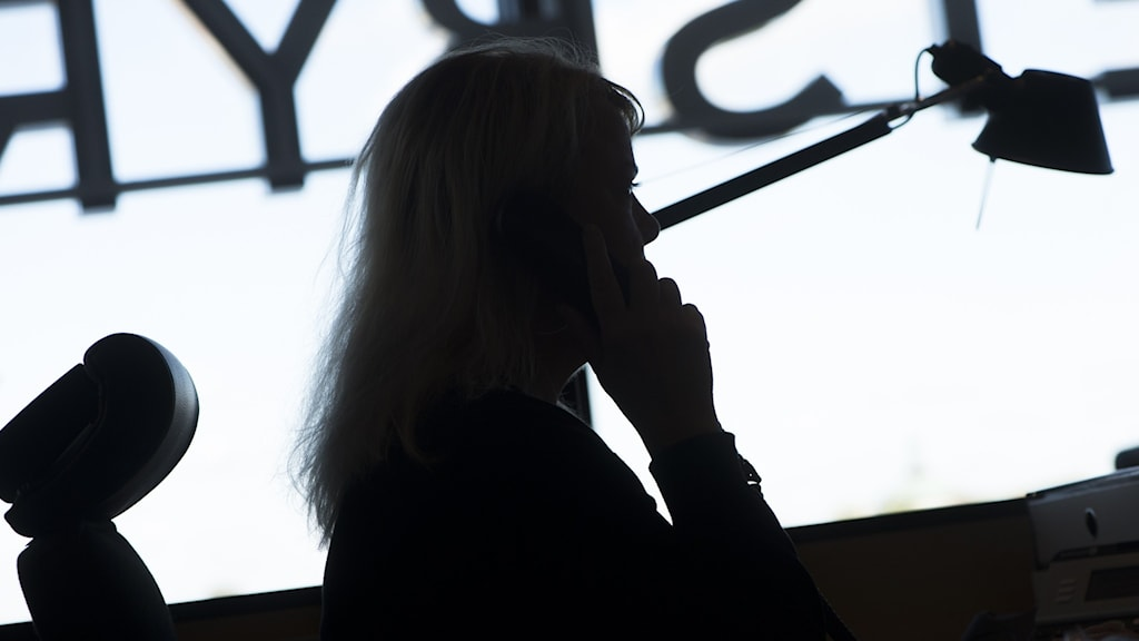 Silhouette of person on the phone.