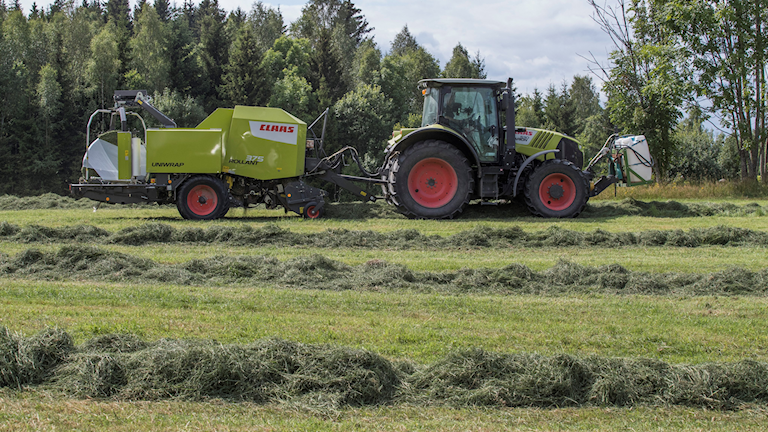 Tractor harvesting hay.