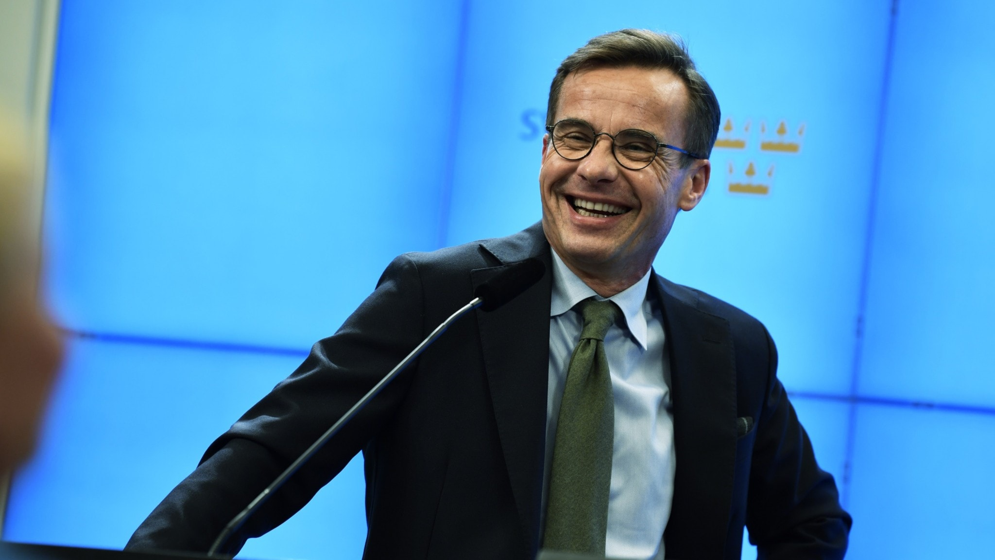 Moderate Party Leader Ulf Kristersson standing at a podium.
