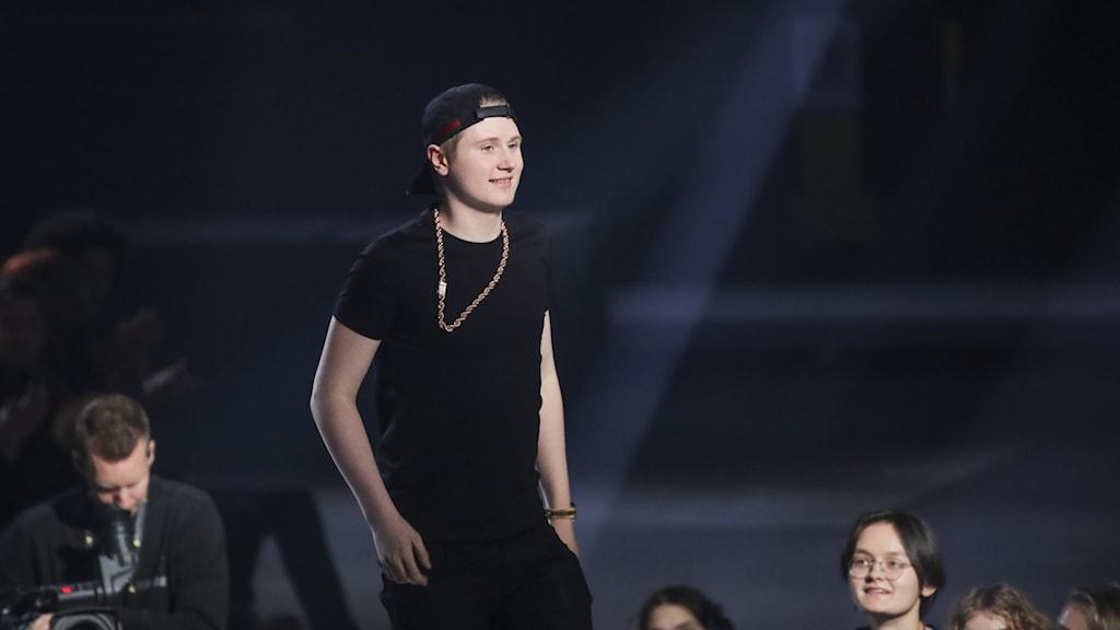 A young man wearing a black t-shirt