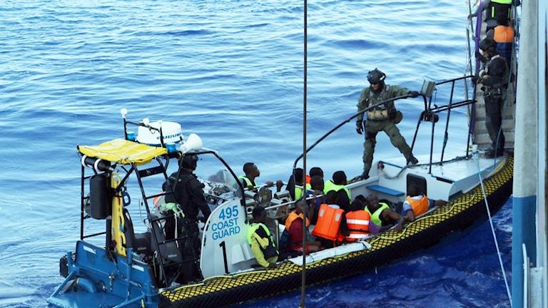 Swedish coast guard helping people.