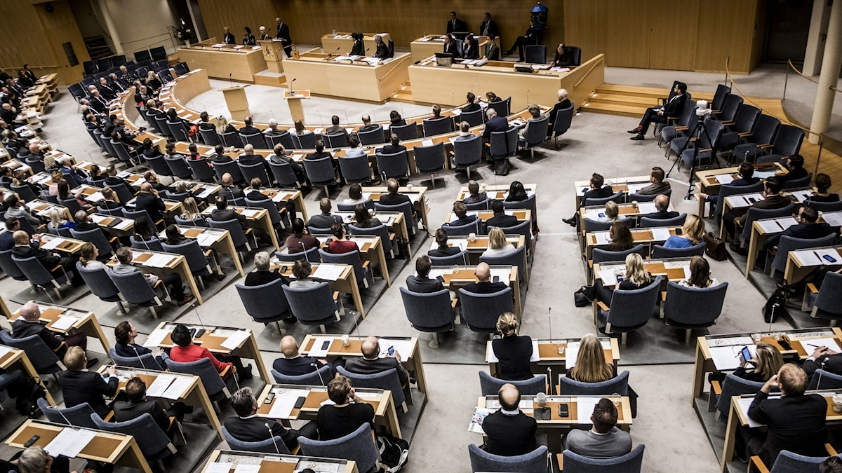 The hall of the Riksdag showing members sitting and voting.