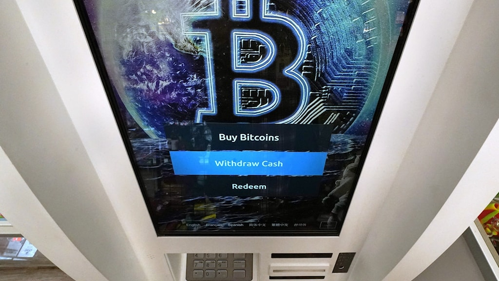 The bitcoin logo on a crypto currency ATM.