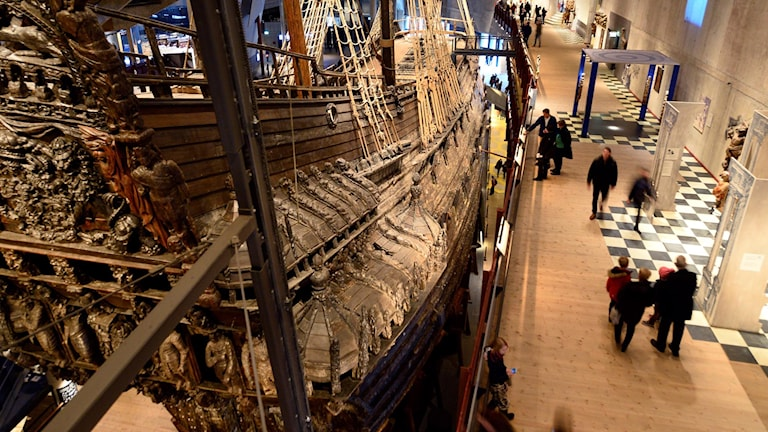 The Vasa ship with people walking on the ground floor.