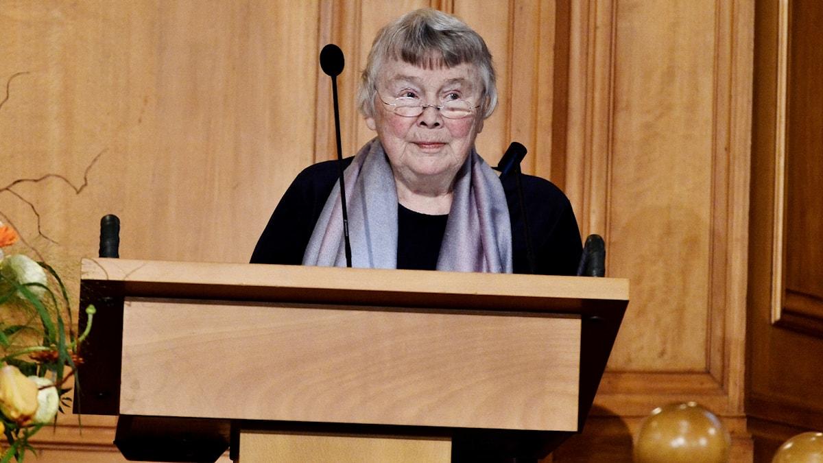A woman at a lectern