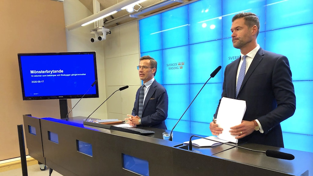 Two Moderate Party representatives dressed in suits hold a press conference on September 17th 2020.
