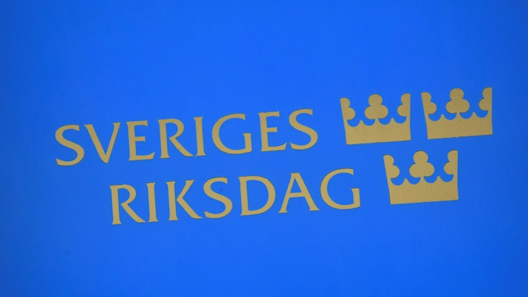 blue sign with gold lettering and triple crown