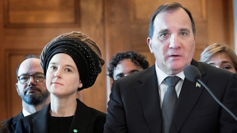 A woman and a man at a press conference