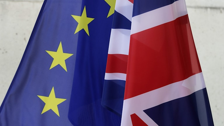 A british and EU flag side by side