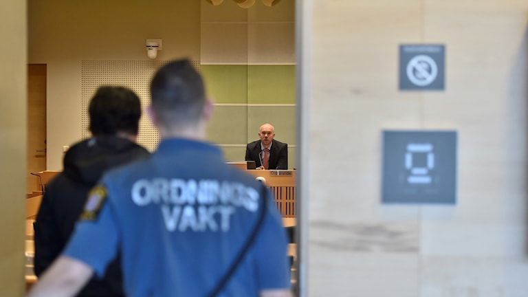 A security guard and the Södertörn court where the trial happened