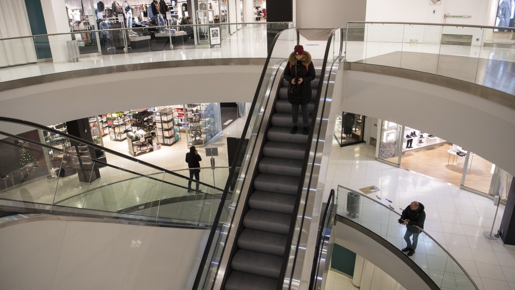 Almost empty escalator in a shopping mall.