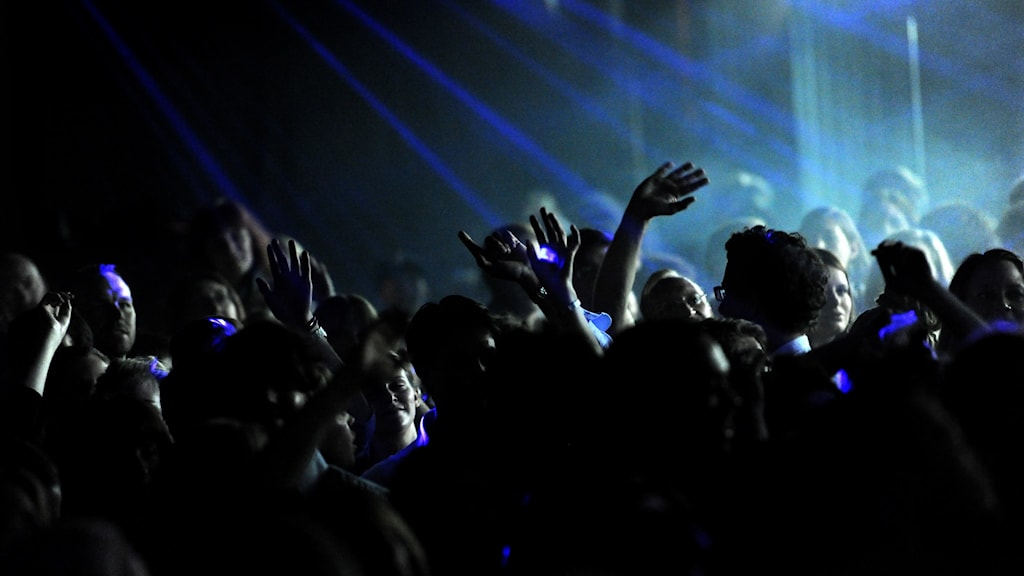 People dancing inside a club.