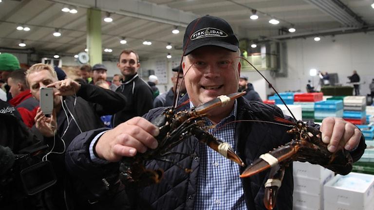The winning bidder at Gothenburg's lobster auction.