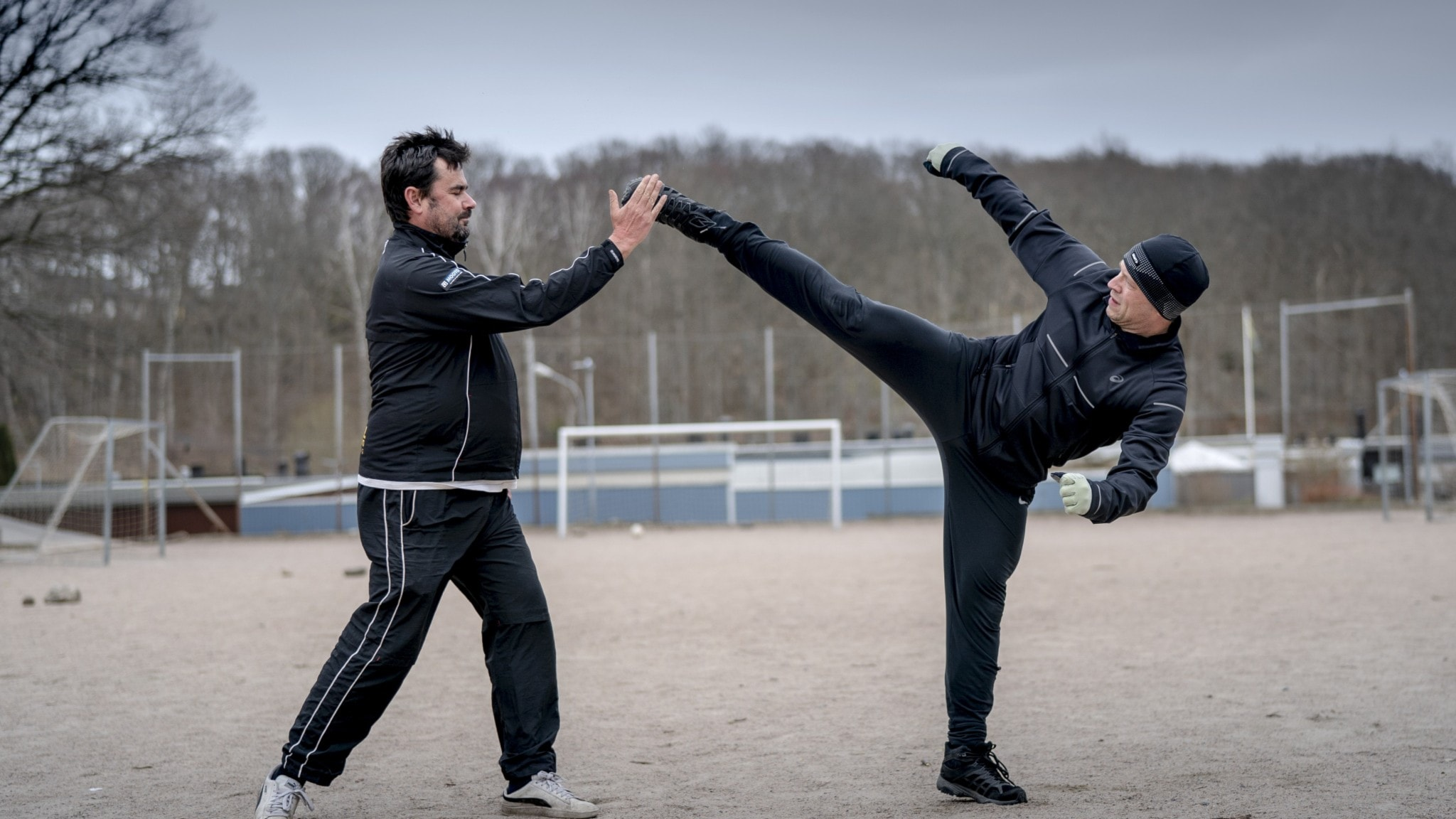 Two people performing taekwon-do.